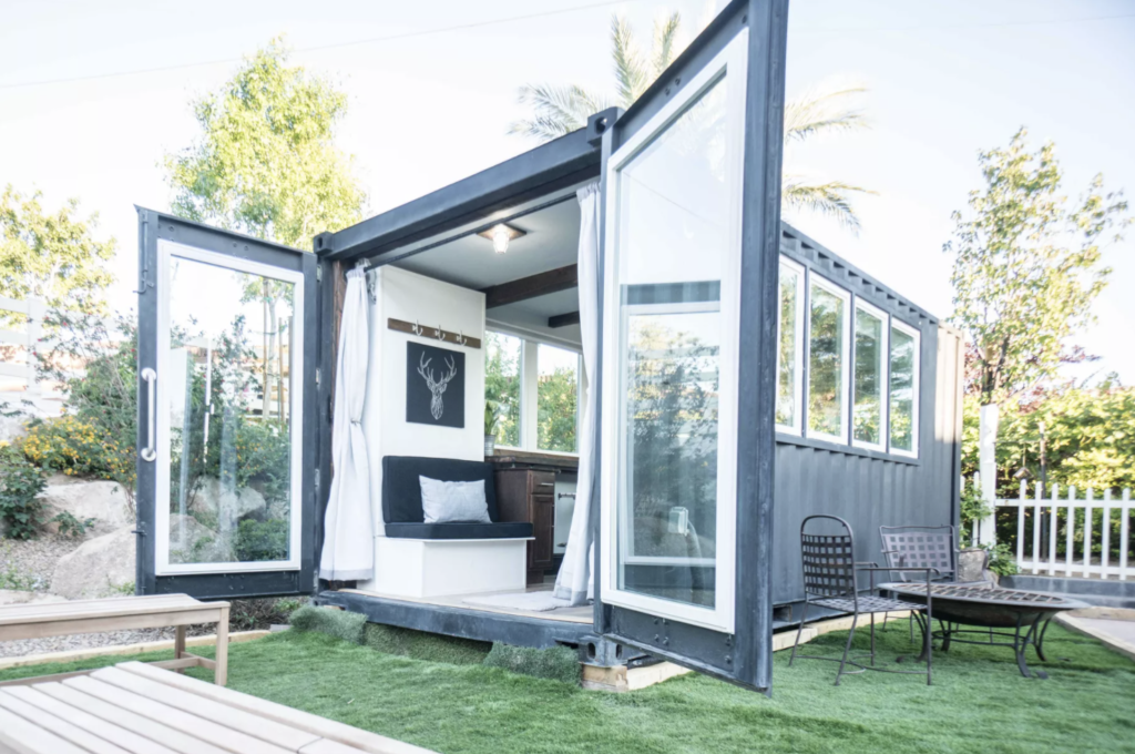Open Window and Rustic Interior Design Make Shipping Container Home Feel Big