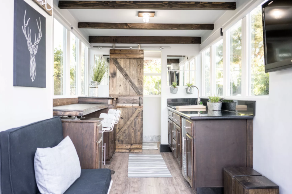 Wood accents and sliding door for cozy feel