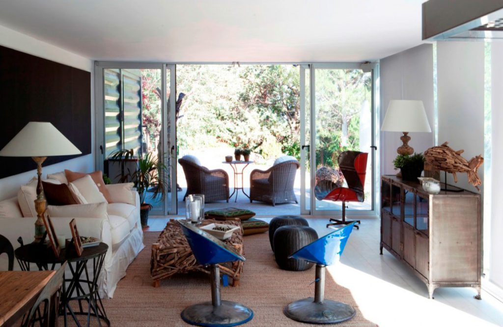 Open concept interior design with slide doors to the porch area